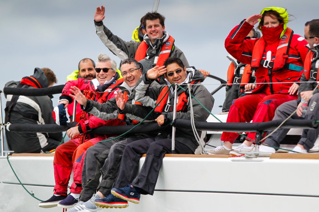 Smiling faces on a corporate yacht charter